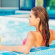 Woman in bikini relaxing in jacuzzi — Foto Stock