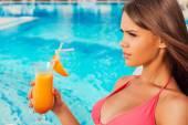 Woman in bikini holding cocktail — Stock Photo