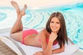 Woman in bikini lying on the deck chair — Stock Photo