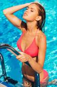 Woman in bikini adjusting her wet hair — Stock Photo