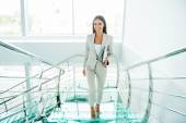 Businesswoman moving up by staircase — Stock Photo