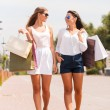 Women with shopping bags walking by the street — Stock Photo #52444787