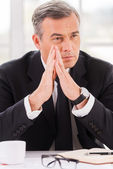 Mature man in formalwear holding hands clasped — Stock Photo