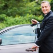 Mature man in formalwear standing near his new car — Stock Photo #52888641