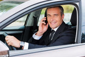 Mature man in formalwear driving — Foto Stock