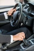 Man in formalwear driving car — Stock Photo