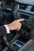 Man in formalwear touching dashboard — Stock Photo