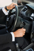 Man in formalwear starting a car — Stock Photo
