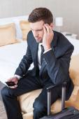 Businessman in formalwear holding mobile phone — Stock Photo