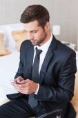 Man in formalwear typing message — Stock Photo