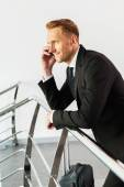 Man leaning at handrail and talking on phone — Stock Photo