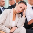 Depressed young woman in conference hall — Stock Photo #52991993