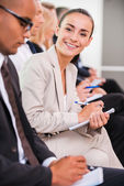 Businesswoman at the conference. — Stock Photo