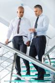 Businessmen discussing business contract. — Stock Photo