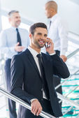Man in formalwear talking on the mobile phone — Stock Photo