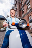 Man riding scooter — Stock Photo