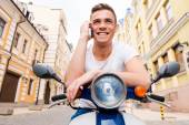 Man sitting on scooter — Stock Photo