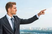 Businessman pointing away — Stock Photo