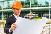Man examining blueprint — Stock Photo