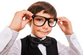Boy adjusting glasses — Stock Photo