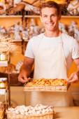 Man in bakery shop — Stock Photo