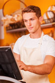 Confident cashier at work — Stock Photo