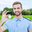 Man holding golf ball — Stock Photo #54240207