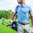 Golfer carrying golf bag — Stock Photo #54240237