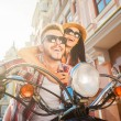Couple riding scooter — Stock Photo #54248503