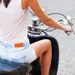 Young woman riding scooter — Stock Photo #54248569