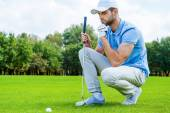 Golfer near golf ball — Stock Photo