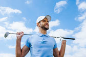 Golfer holding driver — Stock Photo