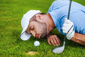 Golfer blowing at ball — Stock Photo