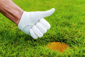Hand in golf glove — Stock Photo
