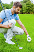 Teeing up — Stockfoto
