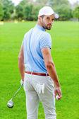 Golfer holding golf ball — Стоковое фото