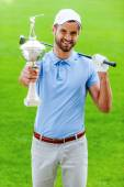 Golfer showing his trophy — Stock Photo