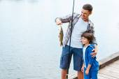 Father holding fishing rod — Stock fotografie