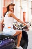 Woman riding scooter — Стоковое фото