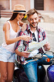 Couple sitting on scooter — Stock Photo