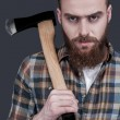 Young bearded man carrying a big axe — Stock Photo #54827711