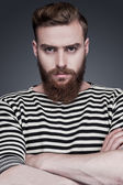 Bearded man in striped clothing — Stock Photo