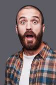 Shocked young bearded man — Stock Photo