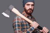 Bearded man holding a big axe — Stock Photo
