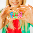 Little girl holding colorful plastic letters in hands — Stock Photo #54916675