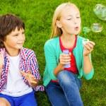 Little children blowing soap bubbles — Stock Photo #54916985