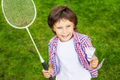 Little boy holding badminton racket and shuttlecock — Stock Photo