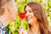 Woman and her boyfriend holding lollipop — Stock Photo