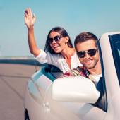 Couple enjoying road trip in convertible — Stock Photo