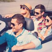 People enjoying road trip in convertible — Stock Photo